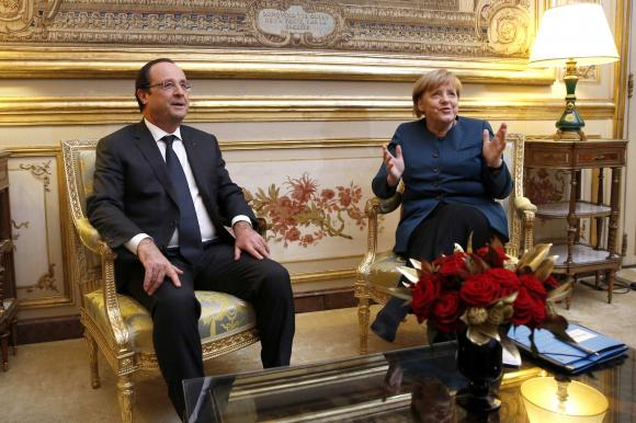 French President Hollande and German Chancellor Merkel meet at the Elysee Palace, in Paris